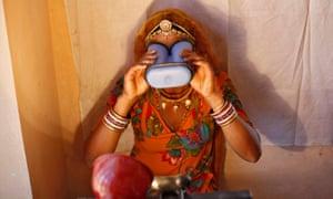 A villager uses an iris scanner
