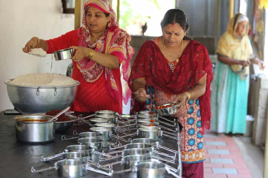 Members of the Kudumbhashree collective pack lunches for Kochi Metro staff