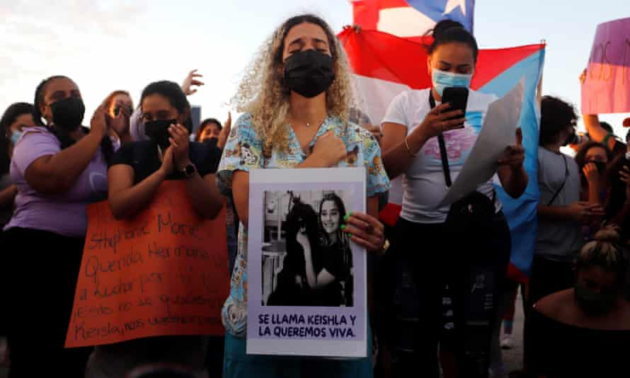 The sister of Keishla Rodriguez takes part in a protest following the death of her sibling