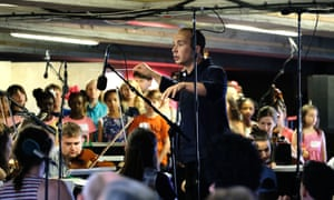 Conductor Christopher Stark leads the orchestra and young singers during Proms at ... Bold Tendencies multi-storey car park, Peckham.