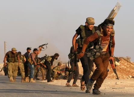 Fighters from the Free Syrian Army take part in a battle against Isis in the northern Syrian village of Yahmoul.