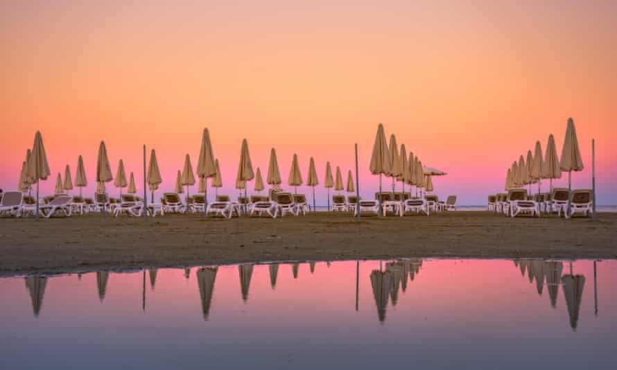 Sunbeds on the beach of Larnaca, Cyprus.