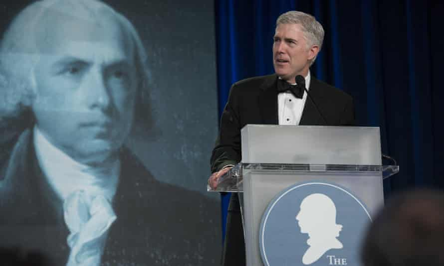 Supreme court justice Neil Gorsuch speaks at the Federalist Society's 2017 convention in Washington, watched by James Madison.