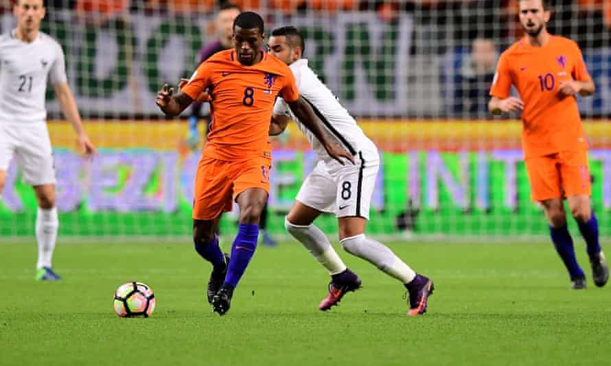 Georginio Wijnaldum, centre, in action for Holland against France in Amsterdam. The midfielder injured his right hamstring during the World Cup qualifier.