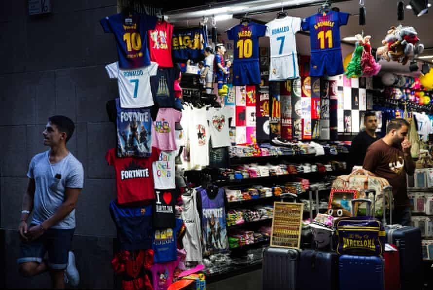 Stall selling replica football shirts in Barrio Gotico, Barcelona.