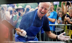 Joe Biden smiles for the media while frying steaks at the Polk County Democrats' Steak Fry in Des Moines, Iowa on Saturday.
