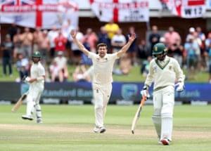 England's Mark Wood celebrates the wicket of South Africa's Keshav Maharaj.