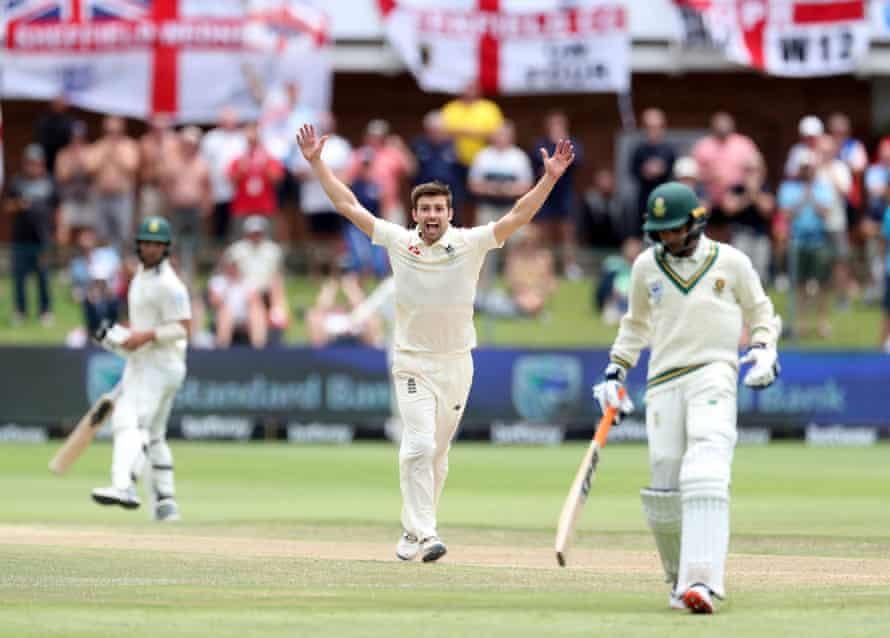 Mark Wood celebrates the wicket of South Africa's Keshav Maharaj.