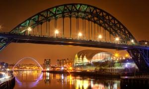 Tyne Bridge at night, with the Millennium Bridge and Sage in background.