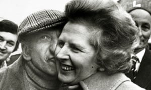 Conservative Party leader Margaret Thatcher gets a kiss from Petticoat Lane stallholder Lew Pickle on 12 April 1979, as she continues to woo the working class on the general election campaign trail.