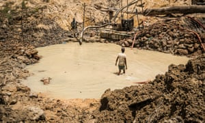 A man walking in the pool in a goldmine in the Mazaruni region of Guyana in April this year. Venezuela has claimed ownership of the gold-rich region since the mid-19th century.
