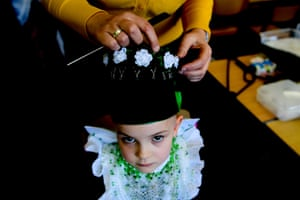 A Sorbian child being dressed by Petra Kupke