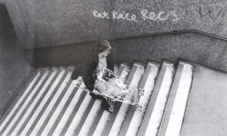 A daily struggle … Matrix founding member Anne Thorne carries a pushchair up the steps of a subway in Aldgate, east London.