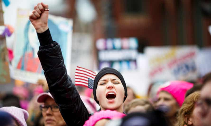 A woman cheers during the Women's March in Washington DC, on 21 January.