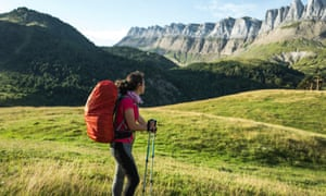 Female Hiker Looking At Mountains