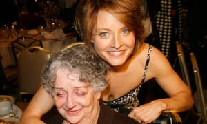 Jodie Foster in 2007 standing behind her mother with her arm around her