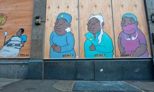 Street art in South London by Deanio_X, on a boarded-up pub, representing BAME NHS staff.