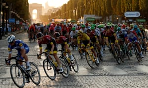 Egan Bernal in the leader's yellow jersey amid the peleton on the Champs Élysées, on the verge of winning last year's Tour de France