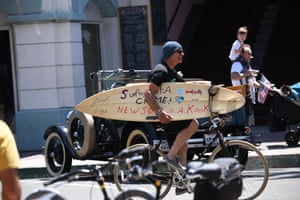 A surfer taking part in the protest in Huntington Beach.
