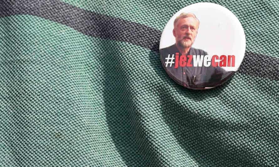 A supporter wearing a Jeremy Corbyn badge