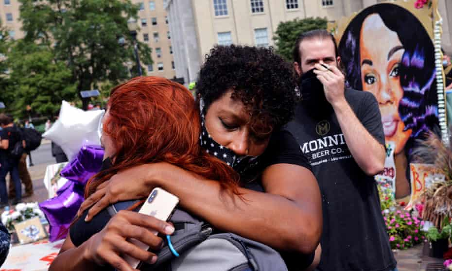 Protesters in Louisville, Kentucky, react after the grand jury's decision was announced in the killing of Breonna Taylor.