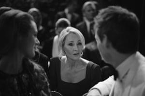 JK Rowling talks to Eddie Redmayne and his wife Hannah Bagshawe.