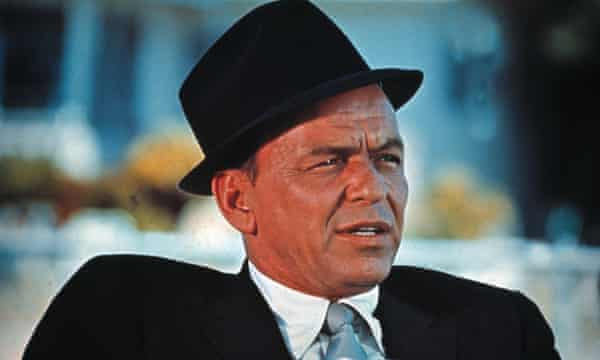 Frank Sinatra in shirt and tie and trilby