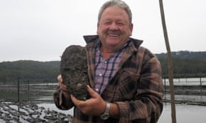 Jack's grower, the oyster farmer Bernie Connell, with Jack on the Clyde river, in New South Wales.