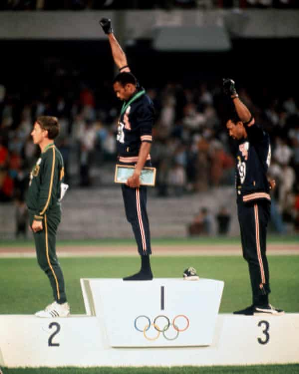Tommie Smith and John Carlos giving the Black Power salute at the Olympic Games in Mexico City, 1968.