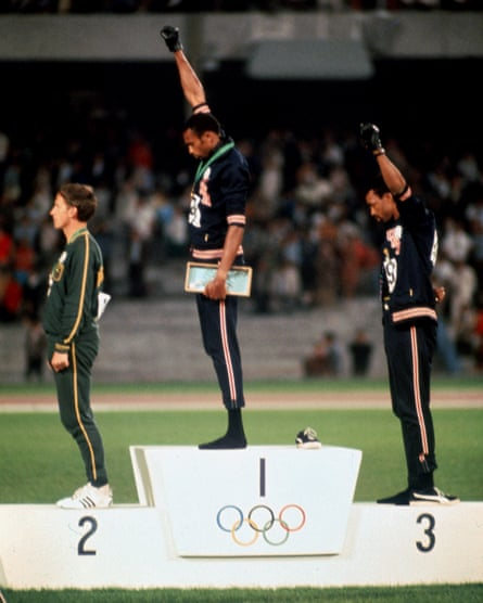 Tommie Smith and John Carlos giving the Black Power salute in 1968.