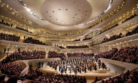 Conductor Thomas Hengelbrock and the NDR Elbphilharmonie Orchestra take the applause after their new hall's opening concert.