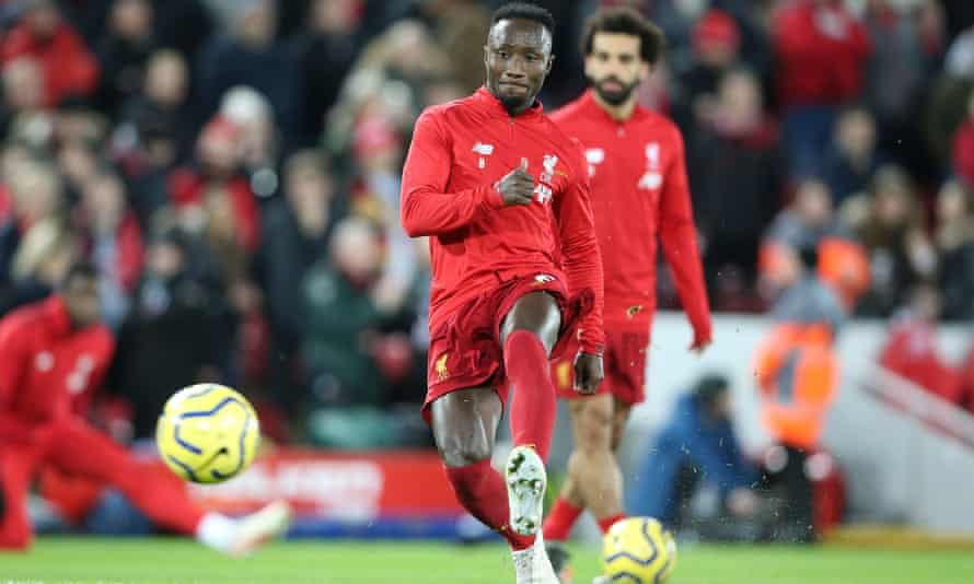 Naby Keïta warming up for Liverpool's match against Sheffield United. He injured his groin and is out of the FA Cup third-round tie with Everton on Sunday.