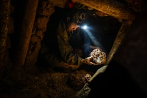 A miner working in a tunnel in a ruby mine in Mogok, north of Mandalay