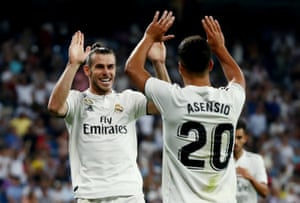 Real Madrid's Gareth Bale celebrates scoring their second goal against Getafe with Marco Asensio.