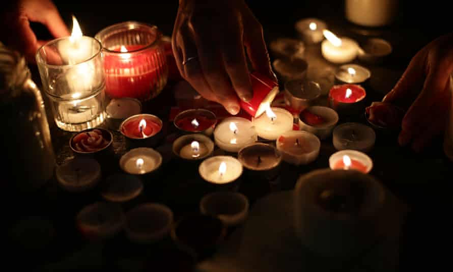 Members of the public light candles during a vigil for the Westminster attack victims in Trafalgar Square.