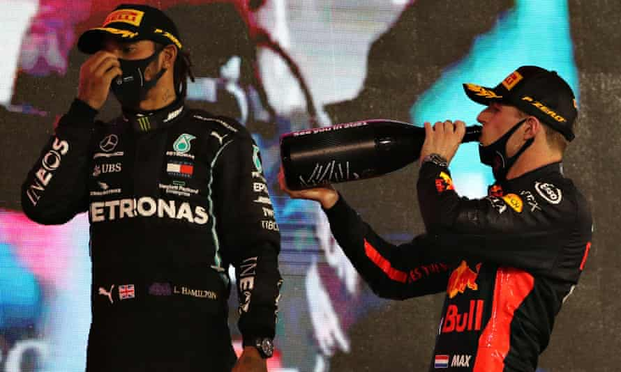 Red Bull's Max Verstappen (right) and third-placed Lewis Hamilton on the podium after the Abu Dhabi Grand Prix at the Yas Marina circuit.
