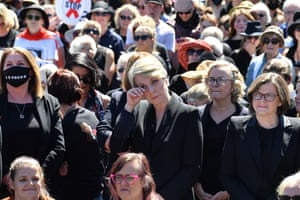 Member for Sydney Tanya Plibersek wipes a tear outside Parliament House.
