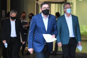 Victorian premier Daniel Andrews (centre), Victorian chief Health officer Brett Sutton (left) and Victorian health minister Martin Foley arrive to a press conference on Sunday.