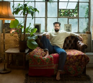 Jack Guinness sitting on a sofa