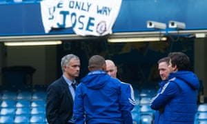 Chelsea manager José Mourinho has a meeting with his staff on the pitch following the 3-1 defeat to Liverpool.