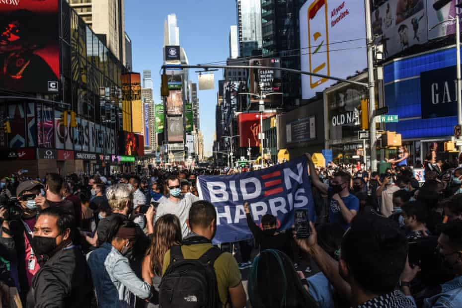People celebrate in Times Square after Joe Biden's victory was announced.
