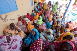 Women forced from their homes by conflict at a makeshift medical centre in Kutum, in the Sudanese state of North Darfur