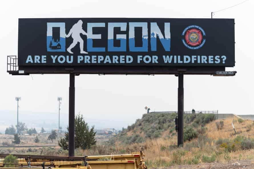 A billboard reading 'Oregon: are you prepared for wildfires' stands on the side of Highway 26 in Madras, Oregon.