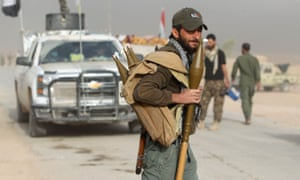 A Shia fighter outside the village of Abu Shuwaiha, south of Mosul
