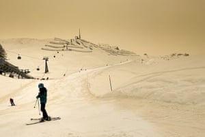 Skiers enjoy the slopes at the Alpine resort of Anzere, Switzerland
