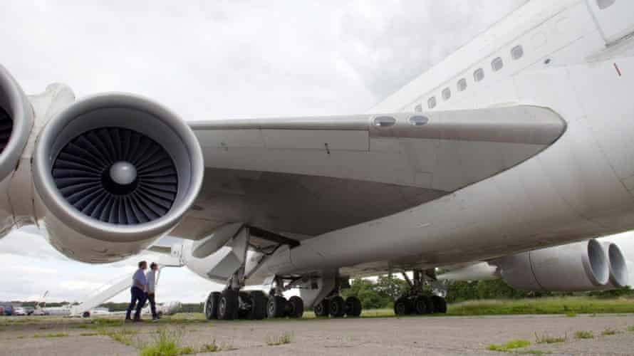 The wheel well of a decommissioned passenger jet is inspected in The Man Who Fell from the Sky.