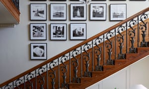 An ornate wooden staircase with iron details