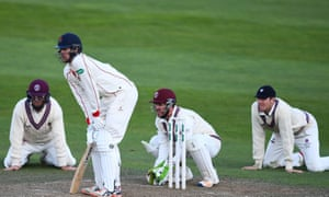 Marcus Trescothick, left, and Craig Overton kneel down while fielding alongside the wicketkeeper during this month's win against Lancashire at Taunton.