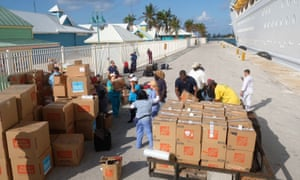 Relief aid is offloaded from a Royal Caribbean ship in Freeport, on 11 September.