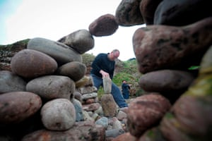 Work begins at the stone stacking competition.